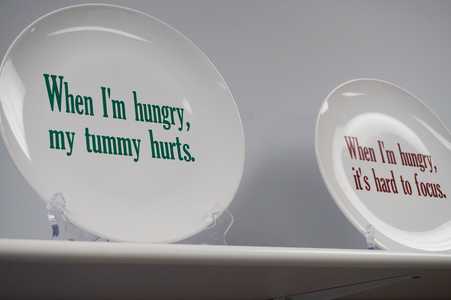 Plates displaying messages of the importance of food for children.