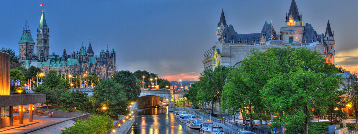 The Rideau Canal at sunset with the Canadian Parliament building in the background.jpg