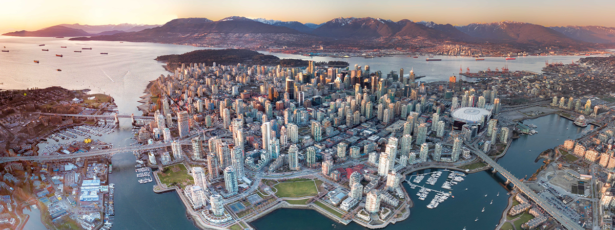 Aerial panoramic view of downtown Vancouver with mountains in the background