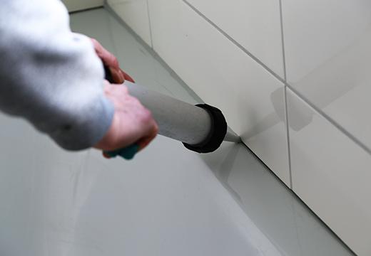 Replacing caulking on bathtub