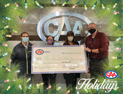 From left: A Meals on Wheels organizer, Cheryl Henderson, Dolores Jasmine, and Peter Van Hezewyk hold Meals on Wheels donation made by CAA Niagara's Light up the Holidays initiative.