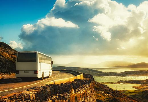 Coach bus driving through stunning landscape