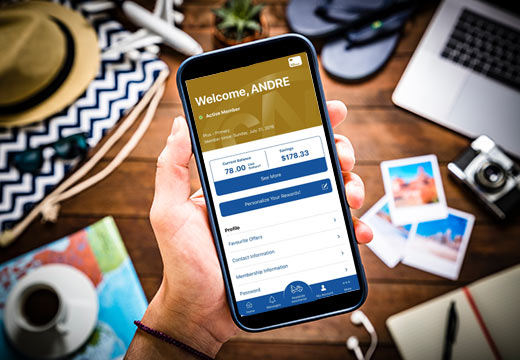 Man planning road trip using CAA Mobile app on smart phone. Viewing Membership screen.