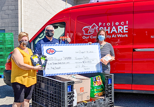 CAA Niagara VP of Automotive Services, Bill Willard, presenting food donations and surprise cheque to Project SHARE_Courtesy of CAA Niagara