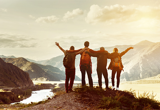 Group of friends looking out at a mountainous landscape